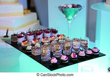 Colorful desserts and pastry served on a party
