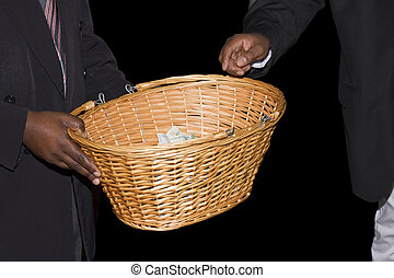 Sunday Church Collection - A basket being passed around at a...