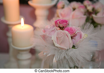 Romantic atmosphere with candle and roses