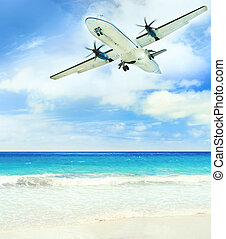 Landing - Airplane landing over the tropical lagoon at sunny...