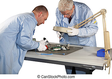 motherboard repairs - IT - engineers doing repairs on a...