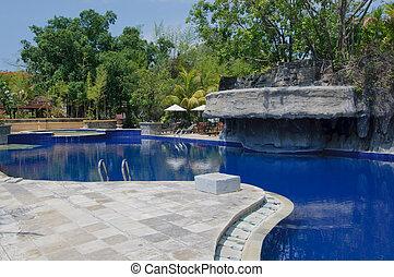 swimming pool at tropical resort