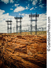 high voltage line over dramatic sky background