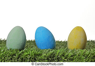 Easter Eggs on Grass - Three Easter eggs on grass on white...