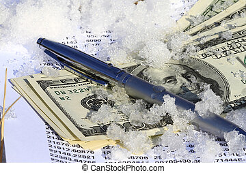 Cold Hard Cash - cold frosted dollar bill stuck in cold snow...