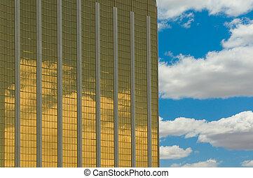 golden skyscraper over blue sky