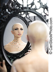 Real bald cancer survivor woman looking calmly into the...