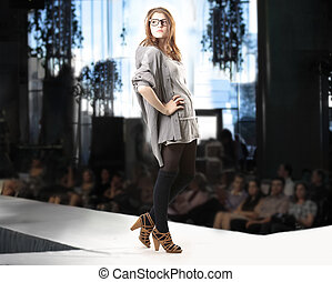 Teenage girl on catwalk at fashion show