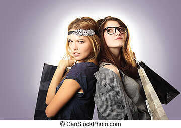 Cool teenage girls fashionista with headpiece and shopping...