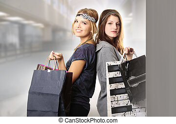 Shopping spree of teenage girls fashionistas at the mall -...