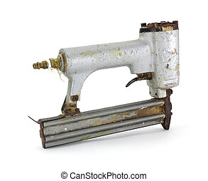 Old nail gun - An old nail gun used for brads on a white...