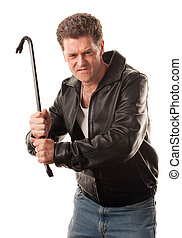 Angry man holding a crowbar - Angry man in leather jacket...