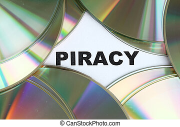 Piracy word written on a pile of dvd disc.