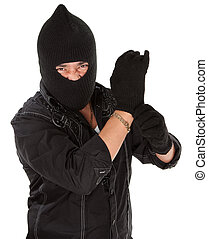 Angry thief - Angry burglar wearing a black woollen mask
