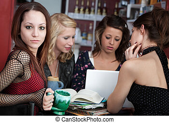 Young girl with friends in a cafe
