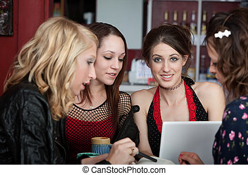 Study Group - Young female college student studying with...