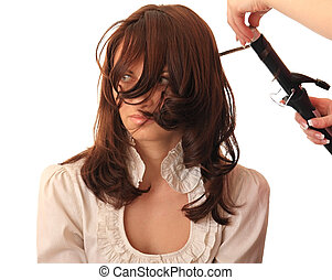 Stylist makes hair beautiful girl.