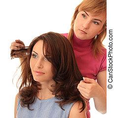 Stylist makes hair