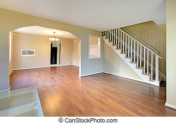 Living room with staircase empty and new