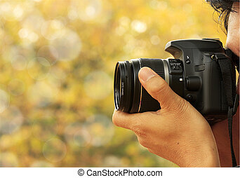 Photographer taking a shoot with a nice bokeh background.