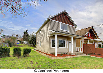 Small beige house with covered entrance