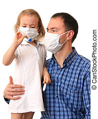 Family in medical masks with a thermometer - Dad with...