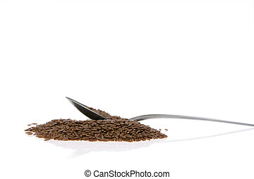 flaxseed - Close up of a pile of flaxseed isolated on white...