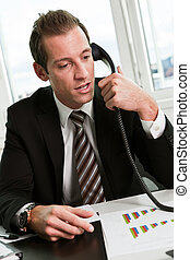 Young businessman speaking on the phone