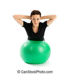 Woman with Pilates Ball - Pretty woman with hands behind...