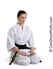 Karate Young girl in a kimono with a white background