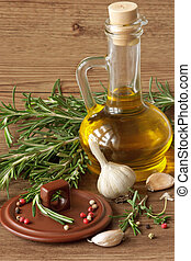 Olive oil and garlic - Olive oil, garlic, peppercorns and...