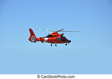 Red Helicopter - A single red rescue helicopter against a...