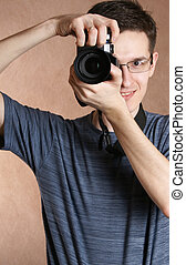 man - photographer, young man with professional camera