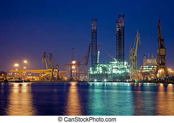 Oil rig in the yards - Night view of yards offshore drilling...