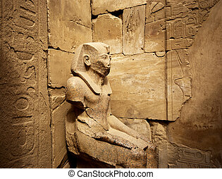 stone statue - a stone statue in the karnak temple in luxor