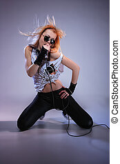 Portrait of female rock singer with microphone