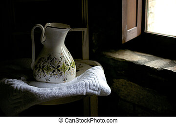 Antique jug - olf wash jug and basin by a window