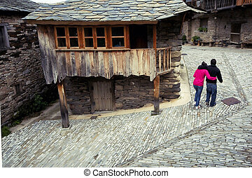 Couple ay old town - young couple walking at small village...