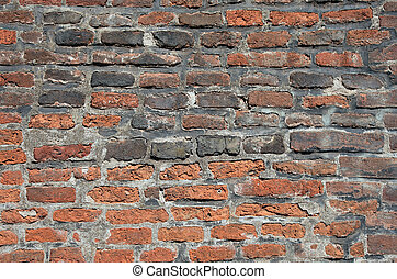Old brick wall in Prague as textured background or backdrop.