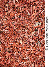 Red woodchips as textured background.
