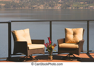 Deck chairs for two on a lakefront deck - Two deck chairs on...