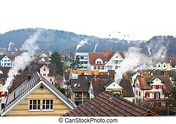 Houses with smoke - Many Houses using a lot of Energy vor...