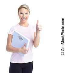woman with a bathroom scale - Gym & Fitness. Smiling mature...