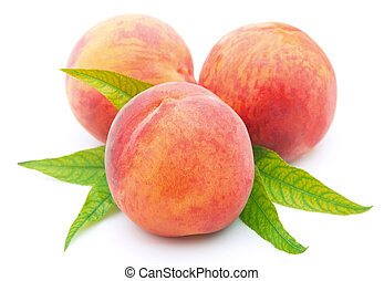 Ripe peaches on a white background