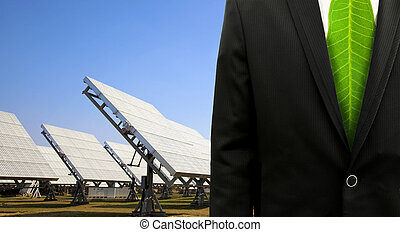 Green business conceptbusiness man with solar power plant