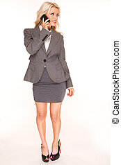 Young business woman talking by phone on white background