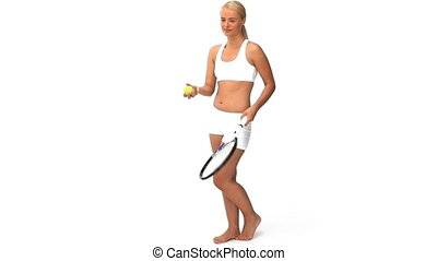 Wonderful blonde woman playing tennis against a white...