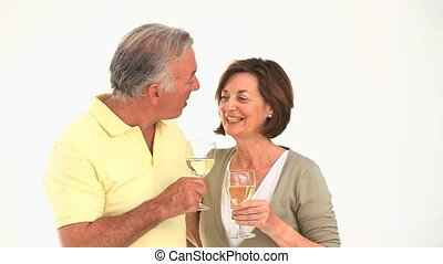 Mature couple drinking white wine - Mature couple drinking a...