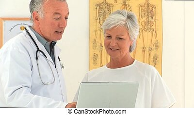 Doctor giving an explanation to his patient at the hospital