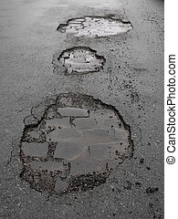 wet city street with potholes - wet city street with...